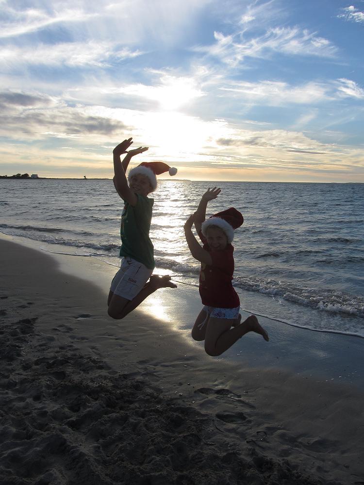 Jumping Santas at the beach